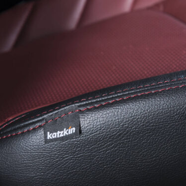 Katzkin Tag on Ford F-150 Red Leather Seat Closeup - Alternate View